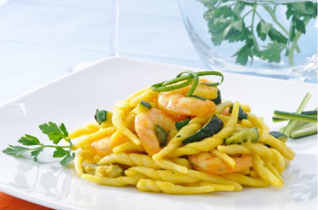 Italian pasta, trofie with zucchini and shrimps